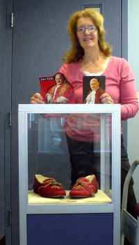 Former Dwyer student stands with papal slippers
