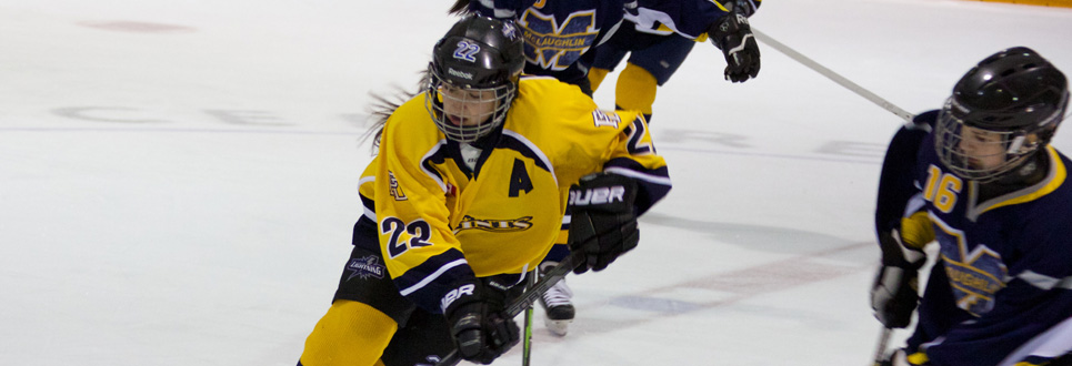 female student skating on ice playing hockey